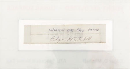 The reverse of the nametag, with Mitchell's signature