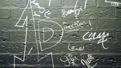 One Direction signed wall
