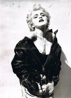 Madonna, photographed by Herb Ritts, wearing denims