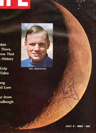 Magazine page signed by Neil Armstrong