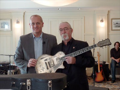 Guitar made from a spacerocket is handed over