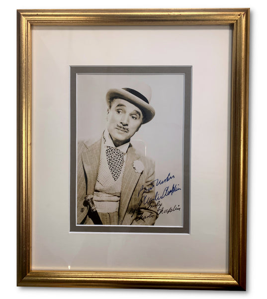 Charlie Chalin signed photograph in a framed display