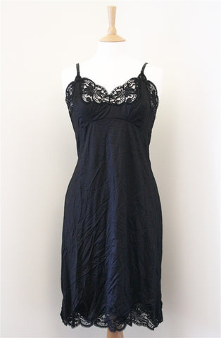 Madonna worn black satin underslip