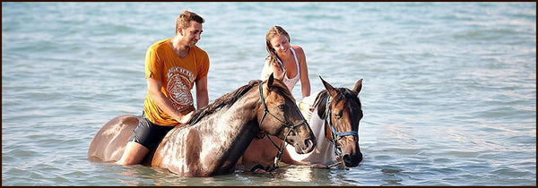 riding in water on a horse