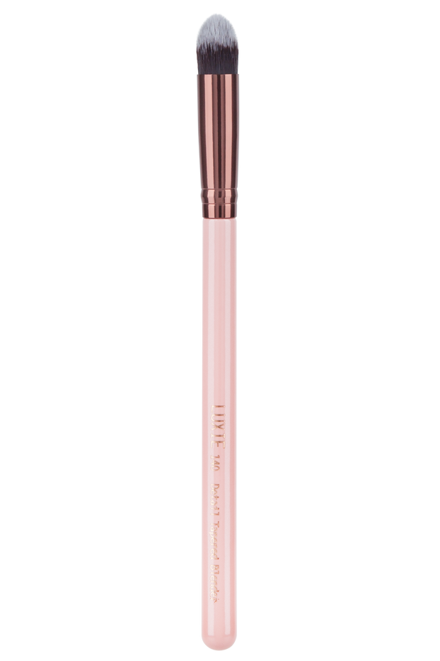 Professional quality results without harming animals or the environment. The perfect contour brush and concealer brush for your beauty needs. A handcrafted blend of soft synthetic hairs, our cruelty-free and vegan makeup brushes are both hypoallergenic and gentle on the skin. With a pink wooden handle and rose gold ferrule, this detailed blender will light up your makeup organizer. Achieve everything from a natural makeup look to an airbrush makeup finish with this tapered blender.