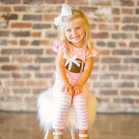 girls pink football outfit