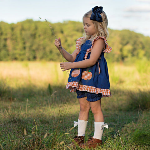 navy and orange girls pumpkin pinafore set