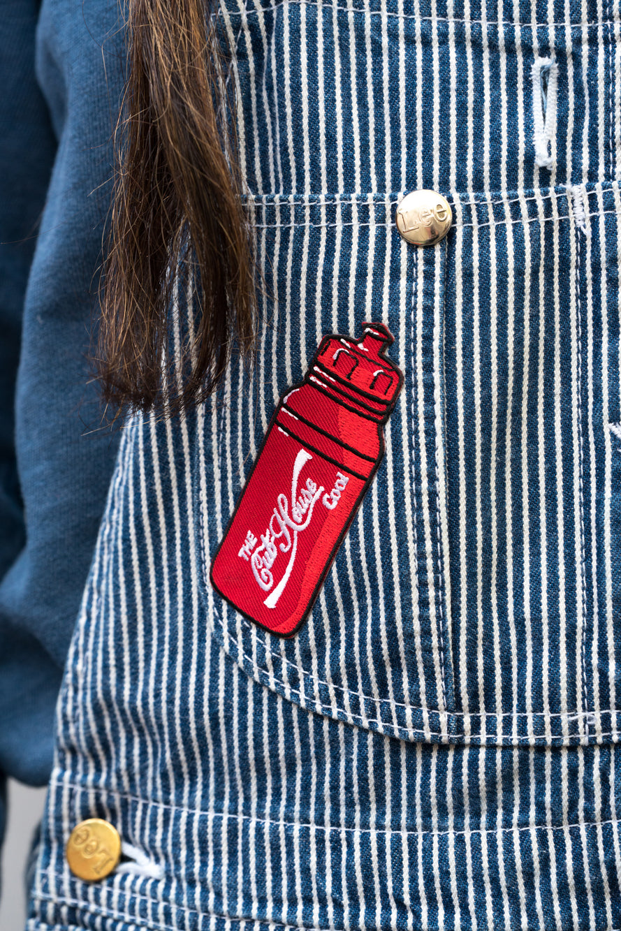 Red Cub House cool bottle patch on striped overalls