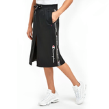 Falda Champion Taped Skirt negra con logo champion en los laterales envío gratis en 24 horas