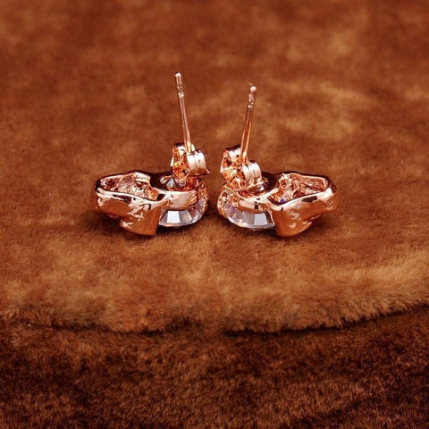 Image of Skull Heads Stud Earring Alpha Bargain