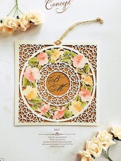 Elegant laser cut baby pink floral wedding invitation.
