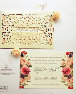 Floral laser cut golden wedding invitation.