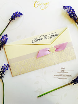 Purple wedding invitation with ribbon.