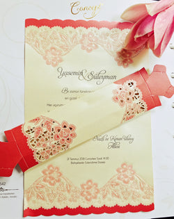 Pink and floral wedding invitation.
