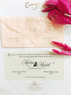 Baby pink wedding invitation.
