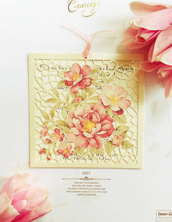 Floral pink laser cut wedding invitation.