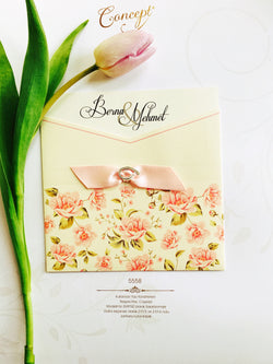 Floral baby pink wedding invitation.