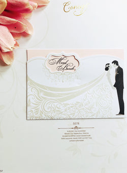 White and pink wedding invitation with groom and bride.