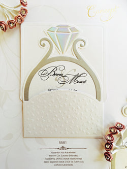 Ring shaped white wedding invitation with hearts.