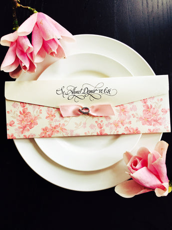 Stunning vintage pink floral wedding invitation with ribbon.