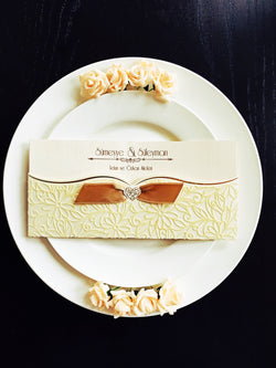 Stunning ivory/gold velvet wedding invitation with ribbon.