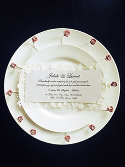 Beautiful white/silver wedding invitation with flower border.