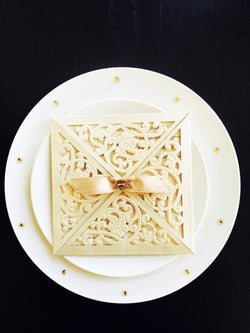 Stunning ivory/gold laser cut personalised wedding invitation with ribbon.