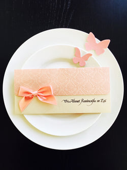 Stunning baby pink and invory wedding invitation with ribbon.