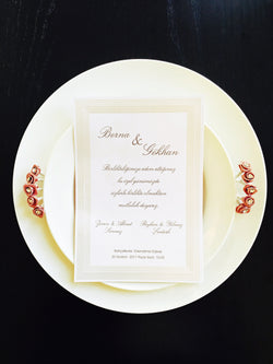 Elegant white/silver wedding invitation.