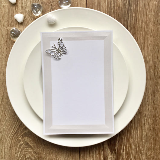 Elegant white/silver  wedding invitation with butterfly.