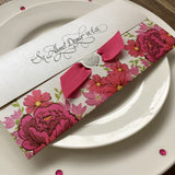 Floral pink personalised wedding invitation.