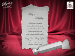 White pearl wedding invitation.