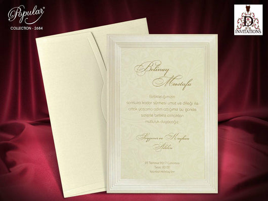 Stunning elegant ivory/golden wedding invitation.
