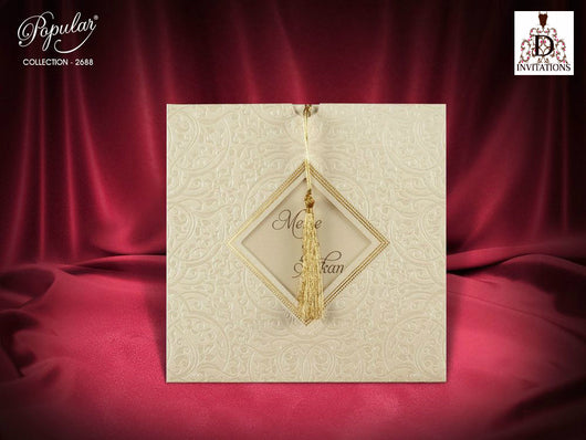 Stunning golden wedding invitation with tassel.