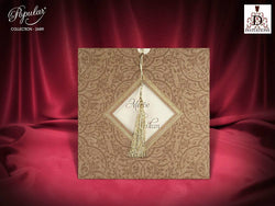 Stunning rustic wedding invitation with tassel.