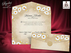 Beautiful folded wedding invitation with camomiles.