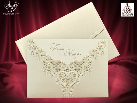Stunning ivory/golden laser cut wedding invitation.