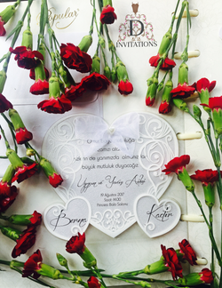 Stunning white heart shaped wedding invitation with ribbon.