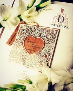 Stunning best selling hessian and lace style wedding invitation with folded card inside.