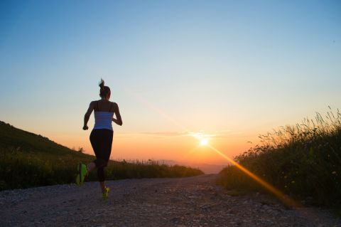 Woman jogging safely at sun set with an IWB holster