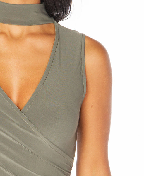 Bella London Sleeveless khaki choker jersey dress with V-neck and cross-over draped front. Detail front photo.