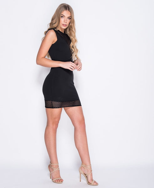 Bella London black bodycon dress with sheer fishnet deep V neck, cap sleeves and hem panel. Front side full length up photo.