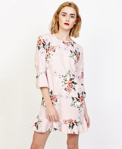Bella London Willa Blush Floral Bell Sleeve Shift Dress With Ruffle Hem. Front View