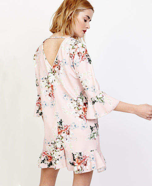 Bella London Willa Blush Floral Bell Sleeve Shift Dress With Ruffle Hem. Back View