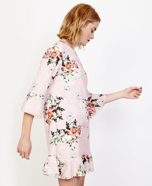 Bella London Willa Blush Floral Bell Sleeve Shift Dress With Ruffle Hem. Side View