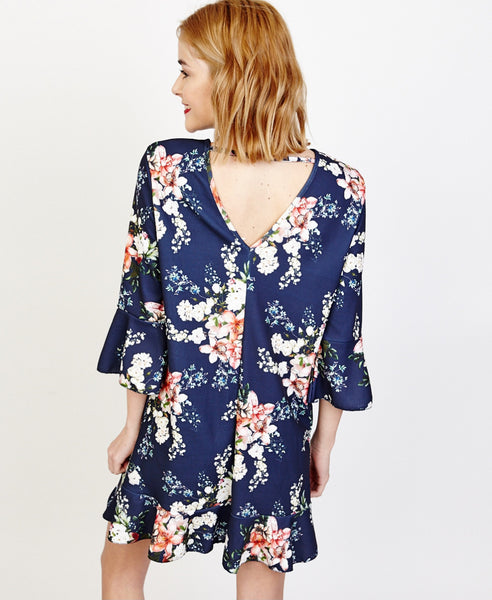 Bella London Willa Navy Floral Bell Sleeve Shift Dress With Ruffle Hem. Back View