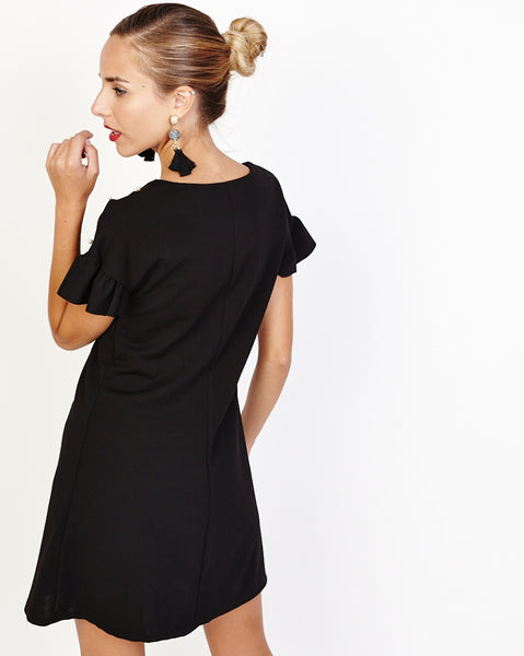 Bella London Ziva Black Shift Dress With Pearls V-Neck And Frill Detail. Back View