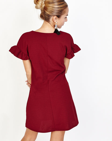 Bella London Ziva Wine Shift Dress With Pearls V-Neck And Frill Detail. Back View