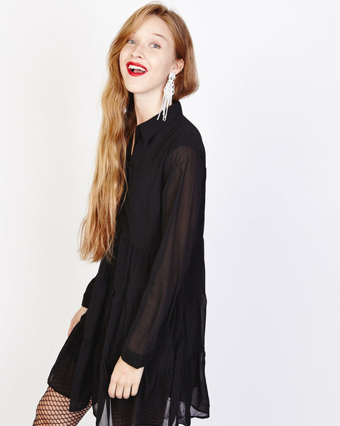 Bella London Paola Black Chiffon Shirt Dress With Sheer Sleeves And Ruffled Skirt. Side View.