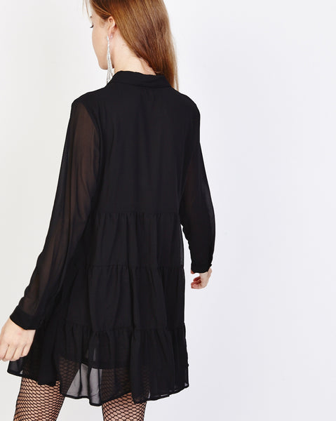 Bella London Paola Black Chiffon Shirt Dress With Sheer Sleeves And Ruffled Skirt. Back View.